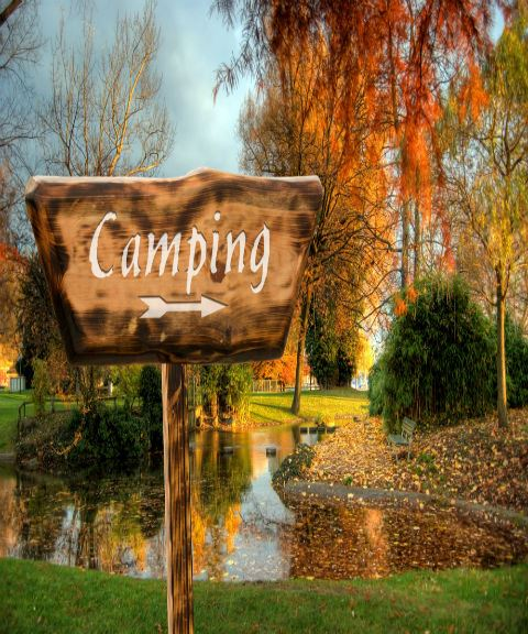 Camping Sign by Pond in Fall
