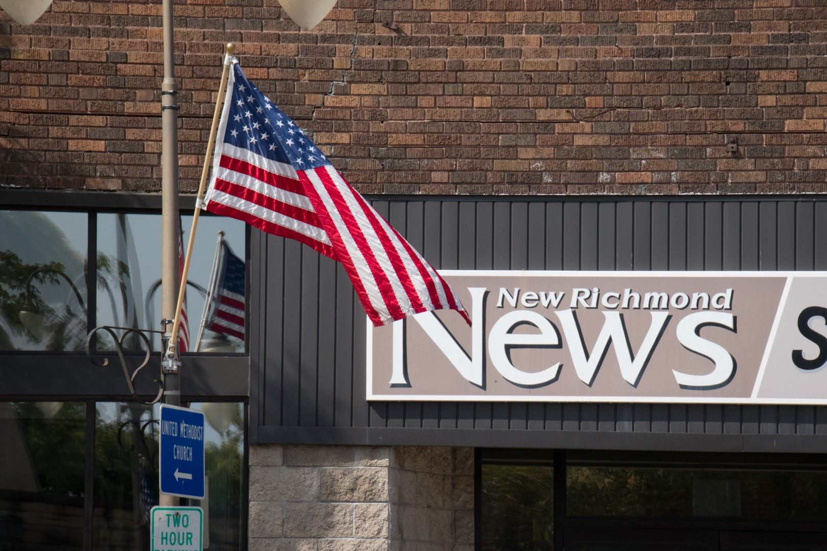 New Richmond News Sign with American Flag